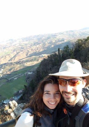 A couple poses on Monte Titano, San Marino.